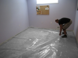 Install a Moisture Barrier. Cover the entire floor area with a 6-mil polyethylene moisture barrier to eliminate moisture migration into your living area.