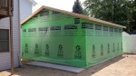 The garage is roofed and wrapped