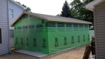 In less than a day, the entire garage is up, enclosed, and roofed with a crew of only 3.