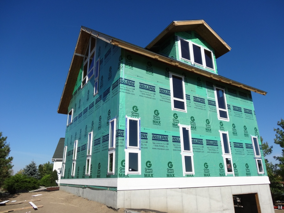 Insulspan Structural Insulated Panels with Housewrap to enclose this home