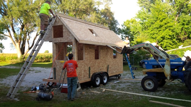 By 2:30 in the afternoon, the last roof panel was being set in place, completing the enclosure.