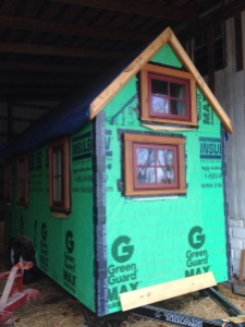 Windows and doors installed, and completed house wrapped, this tiny house is ready for exterior finishes.